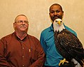 Posing for picture with Bald Eagle. (10594360046).jpg