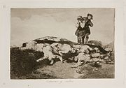 A hillside strewn with naked corpses. A man carries another body about to be added to the pile.