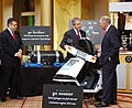 President Bush and Secretary Abraham being briefed on the ECD Ovonics scooter.jpg