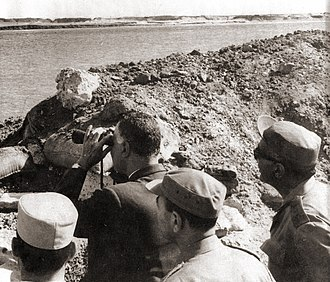 War of Attrition - President Nasser of Egypt (with binoculars), surveys positions at the Suez Canal in November 1968