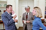 President Ronald Reagan During a Photo Op with Judy Woodruff and Family in The Oval Office NARA 75856513.jpg