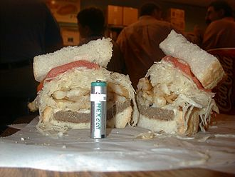 Primanti Brothers - The Primanti Bros. version of a cheese steak sandwich. The AA battery, used as a size reference, is 2 inches (5 cm) tall.