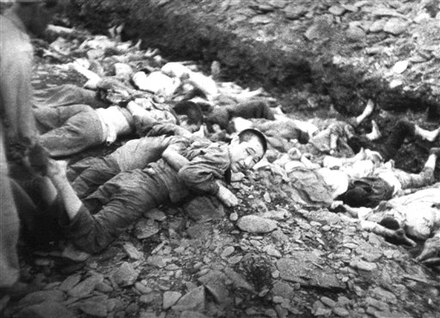 Bodo League massacre during the Korean War in 1950 Prisoners on ground before execution,Taejon, South Korea.jpg