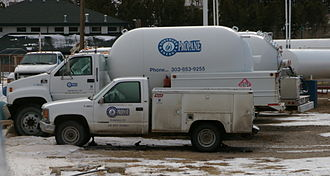 Propane - A local delivery truck, behind the pickup truck