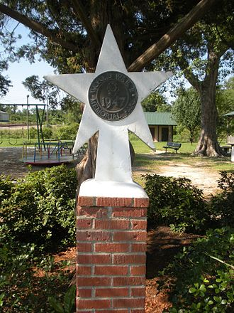 Purvis, Mississippi - Marker dedicating the Purvis City Park to those who served in World War II.