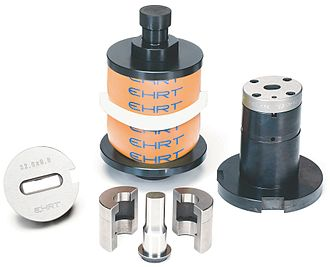 Punch press - Quick change tool system (left:Die, in the front:Punch, Split punch retainer, back: Tool body, right:punch guide)