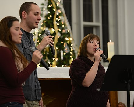 Members of the RAF Mildenhall Praise Team sing in 2013 RAF Mildenhall chapel hosts first Christmas Music Extravaganza 131204-F-DL987-034.jpg