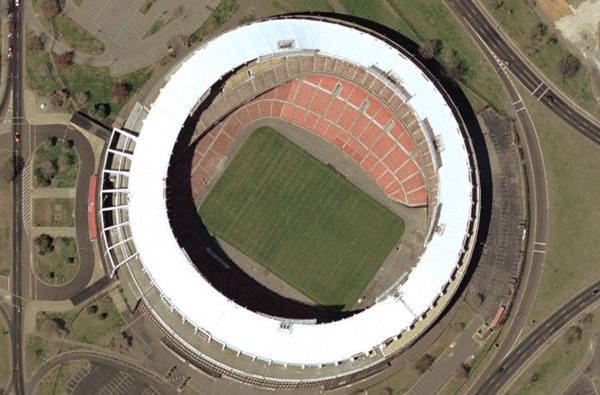 Satellite view of the stadium in pre-2005 soccer configuration; the darker red seats at the northwest end are not part of the current setup RFK Stadium satellite view.png