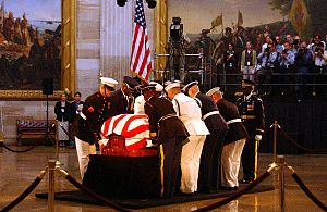 Lincoln Catafalque - A ceremonial Honor Guard prepares to move the flag-draped casket of former President Ronald Reagan during his state funeral in the U.S. Capitol Rotunda.