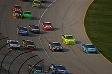 Drivers race on the apron at Chicagoland Speedway (the area between the  white and yellow lines) da4225a81ae