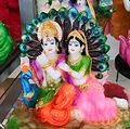 Radha Krishna Images - A statuette of Radha Krishna with a Peacock.jpg