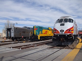 Santa Fe Southern Railway - Santa Fe Depot, with a Rail Runner Express train (right), alongside a diesel locomotive and ex-Santa Fe Pleasure Dome operated by the SFSR