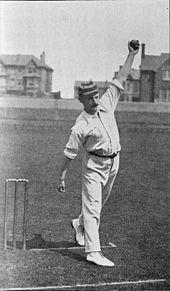 A man bowling a cricket ball