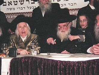 Nigun - The present Kaliver Rebbe at left