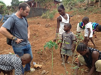 Culture shock - Traveler from Australia visiting a small farm in Sierra Leone.