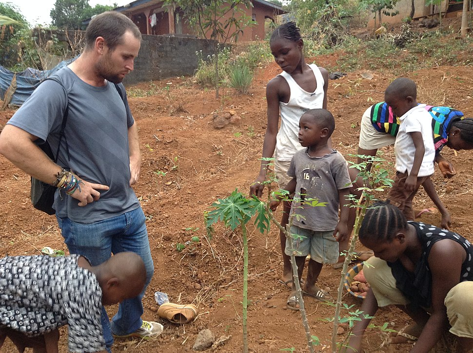 Real African people working on their little farm in Freetown