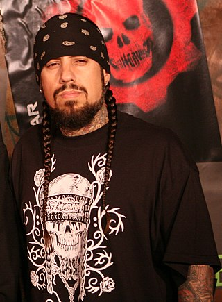 Korn bassist Fieldy (pictured) cites bassists such as Flea of Red Hot Chili Peppers and Les Claypool of Primus as influences. ReginaldArvizu.jpg