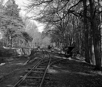 Basingstoke Canal - A light railway track installed on the towpath by volunteers, to aid restoration of the Deepcut Flight of locks.