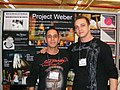 Rich Holcomb and James Waterman displaying the Project Weber poster at the 2010 HIV Prevention Summit in Washington DC..jpg
