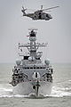 Royal Navy Type 23 Frigate HMS Sutherland with a Merlin Helicopter Overhead MOD 45153369.jpg