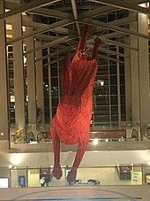 An artwork of a giant red leaping rabbit in Terminal B