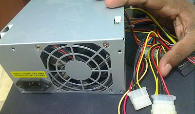 A 450 Watt SMPS for use in personal computers with the power input, fan, and output cords visible SMPS 01.JPG