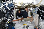 STS-127 Julie Payette and David Wolf in the mid deck of the Space Shuttle Endeavour.jpg
