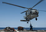 Sailors attach a cargo sling to a Royal Australian Navy S-70B Seahawk helicopter.jpg