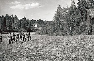 Execution by firing squad - A Soviet infiltrator being executed by a firing squad during the Continuation War