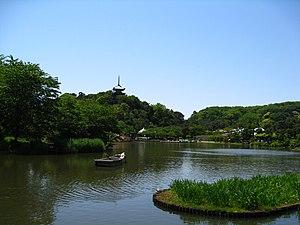 Sankei-en - Sankei-en's Main Pond with Tōmyō-ji's former Three-storied Pagoda in the background