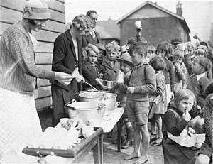 1934 in Australia - Schoolchildren line up for free issue of soup and a slice of bread in the Depression, Belmore North Public School, Sydney, 2 August 1934 (photographed by Sam Hood)