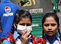 Schoolgirls - One with Anti-Pollution Mask - Chittagong - Bangladesh (13080698035).jpg