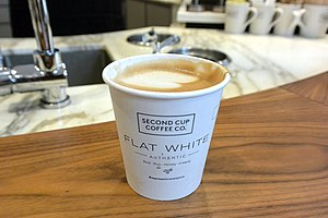 "Flat white - A Flat White beverage made by Canadian coffee chain ""Second Cup"""