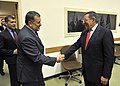 Secretary of Defense Leon E. Panetta shakes hands with Afghanistan's Minister of Defense Bismillah Khan Mohammadi as Panetta attends meetings with other NATO member defense counterparts at NATO Headquarters in Brussels.jpg