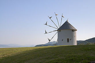Shōdoshima - The windmill on Shodoshima Olive Park is presented to Shōdo Island from Milos