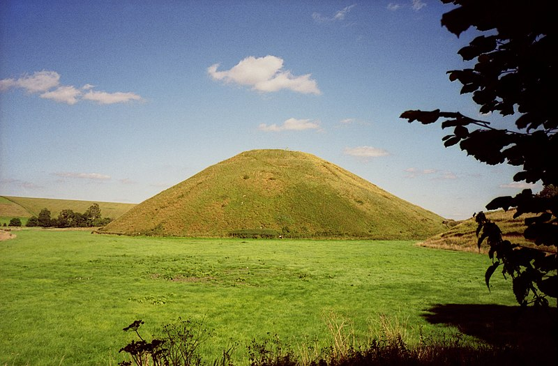 The Neolithic site of Silbury Hill in Wiltshire, southern England, is one example of the large ceremonial monuments constructed across the British Isles in this period. SilburyHill gobeirne.jpg