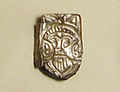 Silver pendant with a depiction of a bearded man from Morrione, Italy.jpg