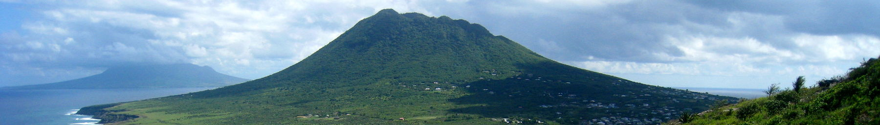 A view of the Atlantic coast of Sint Eustatius with The Quill visible in the distance