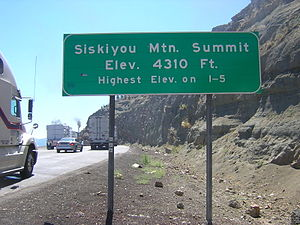 Siskiyou Summit - Siskiyou Mountain Summit marker at southbound truck brake check area