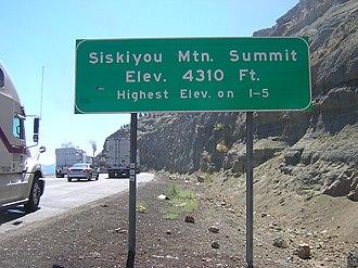 Siskiyou Summit - Siskiyou Mountain Summit marker at southbound truck brake check area