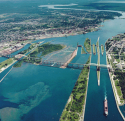Aerial view of the St. Marys River; Whitefish Island is just to the left of the rapids.