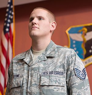Spencer Stone - Staff Sergeant Stone listens as the responsibilities of non-commissioned officers are read during a promotion ceremony at Travis Air Force Base, California, October 30, 2015. Following his promotion to senior airman minutes earlier, Stone was promoted to the rank of staff sergeant.