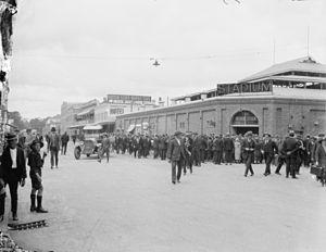 Brisbane Festival Hall - People milling around the entrance of the Brisbane Stadium, circa 1925