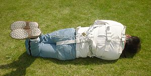 Straitjacket - A Posey straitjacket (medium-size) with added restraints seen from the rear.