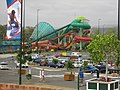 A view across Dreamworld and WhiteWater World's car park towards the Super Tubes Hydrocoaster and The Green Room.