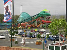 A view across Dreamworld and WhiteWater World's car park towards the Super Tubes Hydrocoaster and The Green Room