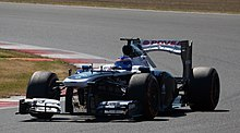 Susie Wolff driving a F1 car exiting a turn