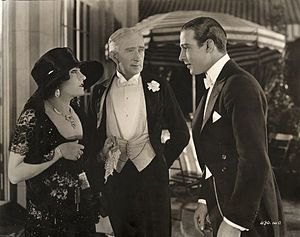 Beyond the Rocks (film) - Theodora Fitzgerald and her father Captain Fitzgerald (played by Gloria Swanson and Alec B. Francis) talk to Lord Hector Bracondale (Rudolf Valentino) in Beyond the Rocks
