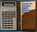 TI BA-35 calculator, power on, in case with QRG (34025369924).png