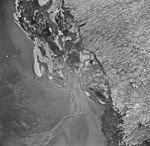 Taku Glacier, terminus of tidewater galcier with braided stream, August 23, 1964 (GLACIERS 6137).jpg